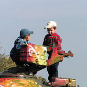 Boys playing with an army tank in Kiev