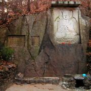Buddha on a wall and a spring