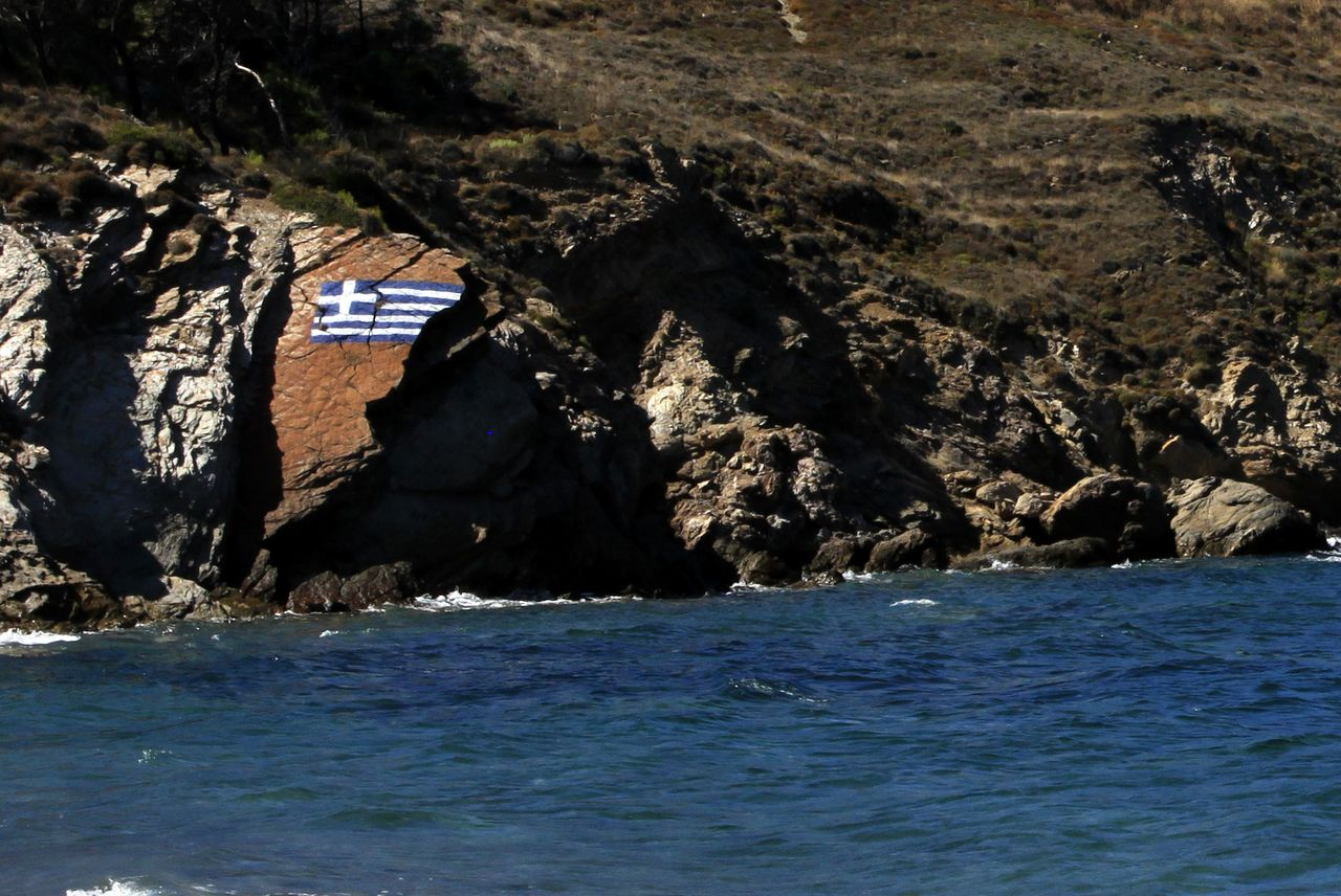 Greek flag on the rock